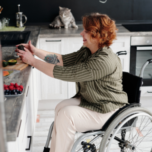 Woman Sitting on Wheelchair While Holding Avocado